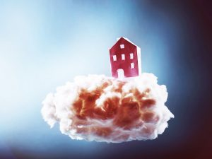 a paper house floating on a cotton cloud