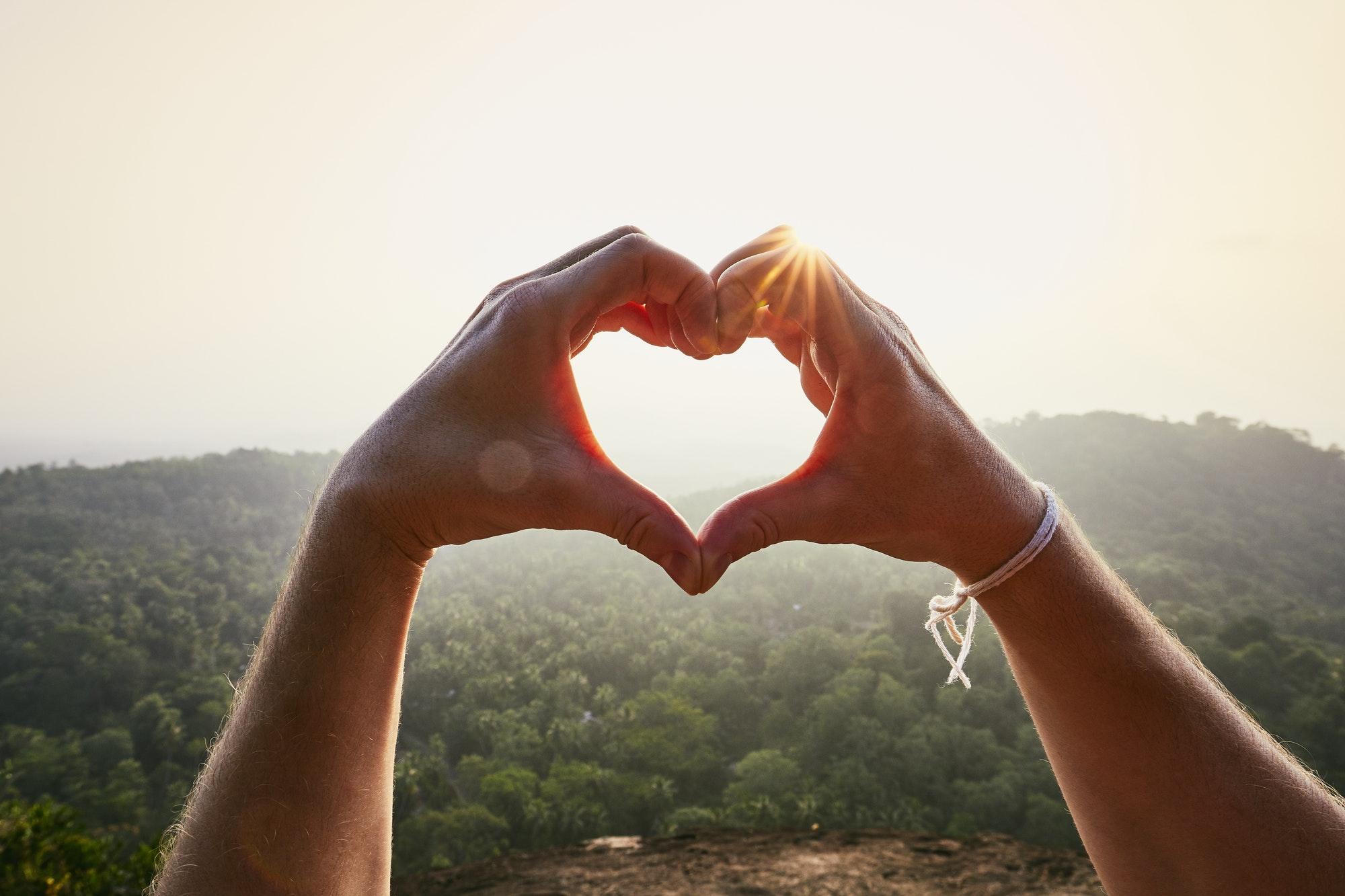 Heart shape against sunset