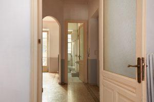 Old apartment interior view with open wooden door
