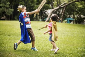 Siblings Playful Dressup Park Concept